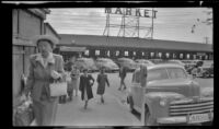 Mertie West walks towards Pike Place Market to shop for cherries, Seattle, 1947