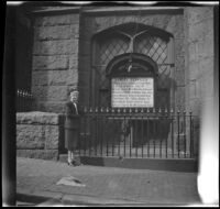 Mertie West standing at entrance to First Methodist Church, Boston, 1947