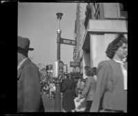 Pedestrians crossing West Street, Boston, 1947