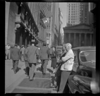 Mertie West stands outside the New York Stock Exchange building, New York, 1947