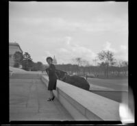 Mertie West on the terrace to the left of the entrance to the National Gallery of Art, Washington, D.C., 1947