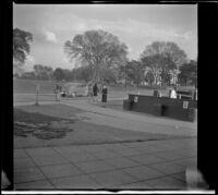 Mertie West on a pathway beside a street, Washington, D.C., 1947