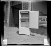 Woodlin electric refrigerator, viewed from the front with its door open, Los Angeles, 1948