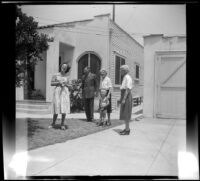 Mrs. Bacon, Mr. Robinson, Mrs. H. H. West with Tommie Newquist and Mrs. Robinson stand in front of the Newquists' residence, Los Angeles, 1948