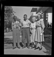 Charles Longstreet, Sam Longstreet, Mrs. Charles Longstreet and Mrs. George Pawley pose outside the Pawley residence, Pasadena, 1948