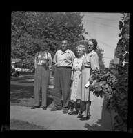 Charles Longstreet, Sam Longstreet, Mrs. Charles Longstreet and Mrs. George Pawley pose outside the Pawley residence on Maple Avenue, Pasadena, 1948