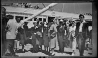 Everett Shaw, Frieda Shaw, Dode Witherby, Mertie West, Will Witherby, Hannah Lockwood, Zetta Witherby, Josie Shaw and Will Shaw stand on the wharf upon arrival in Avalon, Avalon, 1948
