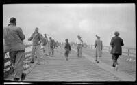 Mertie West strolls down the Ventura Wharf, Ventura, 1948