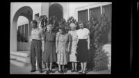 Rudy Newquist, Anna Newquist, Eva Newquist and 2 cousins stand outside the West residence, Los Angeles, 1948