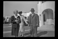 Mertie West, Josie Shaw and Will Shaw stand in the Wests' front yard, Los Angeles, 1948