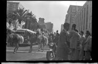 Procession of Shriners ride on horseback down South Olive Street during the 76th annual Shriners convention, Los Angeles, 1950