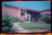 Mertie West, Oel Tallman and Alice Tallman pose in front of the Tallmans' home, Santa Barbara, 1957