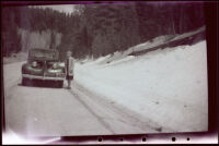 Mertie West beside a roadside snow bank in Kaibab National Forest, 1942