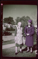Zetta Witherby and Mertie West pose on the front lawn of William Henry Shaw's residence, Los Angeles, 1945