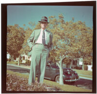 Will Witherby poses outside W. W. Witherby's residence, Los Angeles, 1948