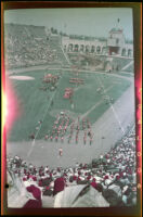 Shriners parade onto Los Angeles Memorial Coliseum's field, Los Angeles, 1950