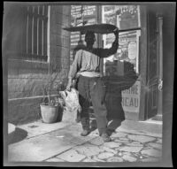 Porter in front of the Henry Gaze & Sons Universal Travel Office, Turkey, 1895