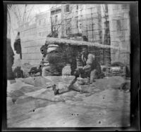 Double exposure photograph showing men in a town and a row of town buildings, Turkey