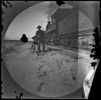 William Sachtleben with his bicycle standing next to a train, Asia, 1891
