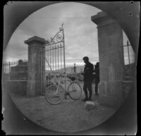 William Sachtleben at the modern gate to the enclosure of the Street of Tombs, Athens, 1891