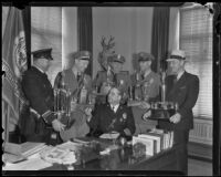 J. J. Engbrecht, Sergeant Joseph O. Dircks, Sergeant M. E. Wheeler, Motor Officer Lee J. Young and Detective Lieutenant Emmett E. Jones surround Chief of Police James E. Davis, Los Angeles, 1936