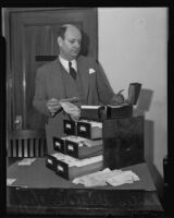 Charles Griffen combs through telegraphic bets for an investigation, Los Angeles, 1936