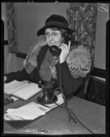 Nellie Brewer Pierce, Republican convention delegate, answers the telephone, Los Angeles, 1936