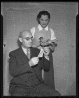 Mayor P. H. McQuillen reads a message from Ellen Highsmith's homing pigeon, Los Angeles, 1936