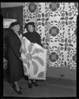 Club members Miriam Leavitt and Rhea Stockwell display quilts, Los Angeles, 1936