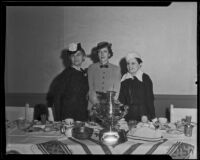 Hollywood Opera Reading Club members Mrs. Ben Lewis, Mrs. Harry Kimball, and Dr. Sonia Poushkareff celebrate Russian heritage, Los Angeles, 1936
