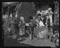 A group of Mascaras and two little girls, Olvera Street, Los Angeles, 1936