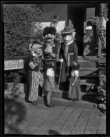 Two little girls and three Mascaras, Olvera Street, Los Angeles, 1936