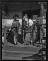 A man and woman dressed as Mascaras, Olvera Street, Los Angeles, 1936