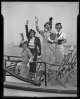 Esther Oatman, Barbara Dawson, Charlotte Craggs, and Leona Lehmer wave from a boat while on their way to an Easter sunrise service, Los Angeles, 1935