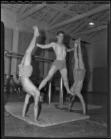 Linden Skundberg, Herbert Hawkins, and Walter Nelson make a statue with their bodies, Chino, 1935-1936