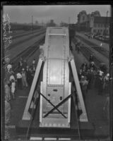 Giant 200-inch telescope lens arrives from New York to San Bernardino, 1936