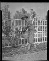 Anna Laura Barnett tends to the garden, Los Angeles, 1936