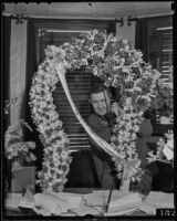 Leland M. Ford receives flowers as County Supervisor, Los Angeles, 1936