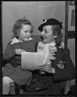 Actress Ann Dvorak with 5-year-old fan Mary Jane Viall, Los Angeles, 1936