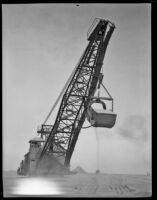 A steam shovel digging in the sand, Calexico, 1936