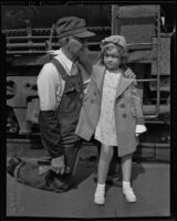 Ginnette Hoyet Marboeu, a French Shirley Temple lookalike, visits the United States with her grandfather, Chas Diffenbaugh, Los Angeles, 1936