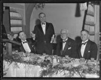 Herbert U. nelson, Walter W. Rose, William May Garland, and Harold Huntsberger at real estate dinner, Hollywood, 1936