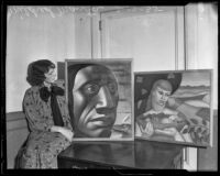 Mildred Manta shows two paintings from the Los Angeles County Relief Administration program, Los Angeles, 1935