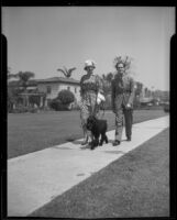 Mr. and Mrs. Anton and Teddy Fera von Horvath walking their dog, Los Angeles, 1936