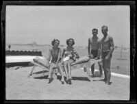 Sisters Kathleen and Renata Titus at the beach with Navy ensigns Walter Combs Jr. and Charles Eisenbach, Newport Beach, 1936
