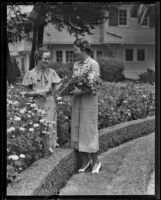 Jean Garrison and Margaret Robinson collect flowers on vacation, Santa Monica, 1936