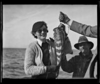 Frank Seebold smiles as Louise Whitney proudly shows off a fish she caught in the Gulf of California, Mexico, 1935