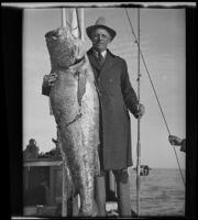 California State Senator Ed Fletcher poses with his catch in the Gulf of California, Mexico, 1935