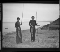 Mildred Fletcher and Louise Whitney stand on the beach with fish they caught in the Gulf of California, Mexico, 1935