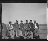 Ralph B. Seeley, Frank Seebold, Mildred Fletcher, Ed Fletcher Jr., Louise Whitney, and Stephen Fletcher sit together on a trailer while on a fishing trip in the Gulf of California, Mexico, 1935